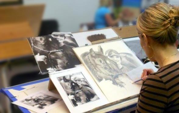 Brenda drawing a portrait